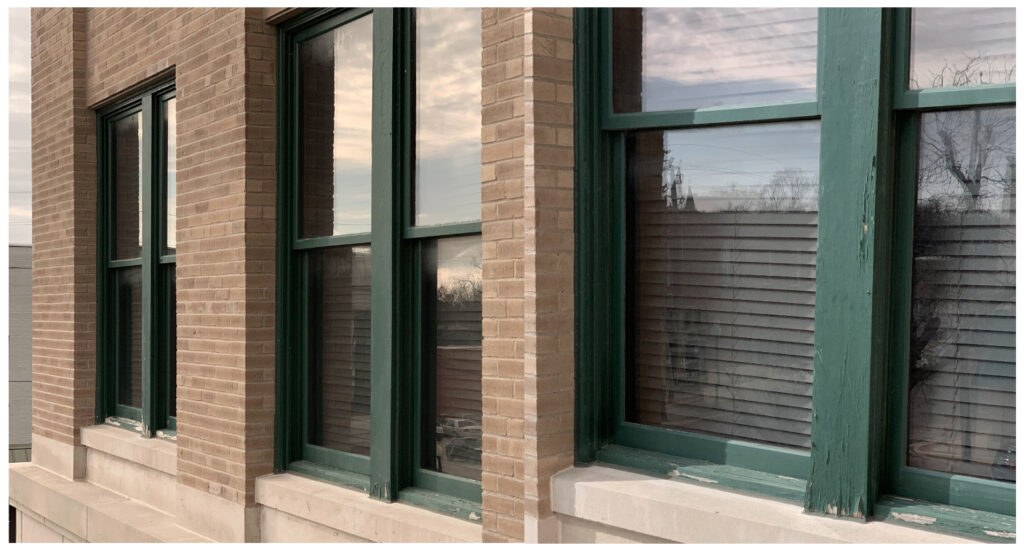 Dark paint on windows cause the wood to peel and moisture to come out.